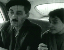 Monica Sevianu (Moni) and Paul Ioanid take a taxi to the scene of the crime -- still from teh 1961 film Reconstituirea.