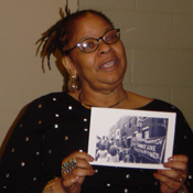 Valerie Stephens-Washington holds a picture of her mother, Marlene Stephens at the rally against violence against women in 1979