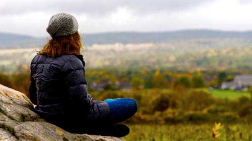 Meg Hutchinson, meditating in the Berkshires. Meditation is just one method – among traditional and alternative therapies – she uses to manage bipolar disorder. Photo courtesy of Ezzie Films.