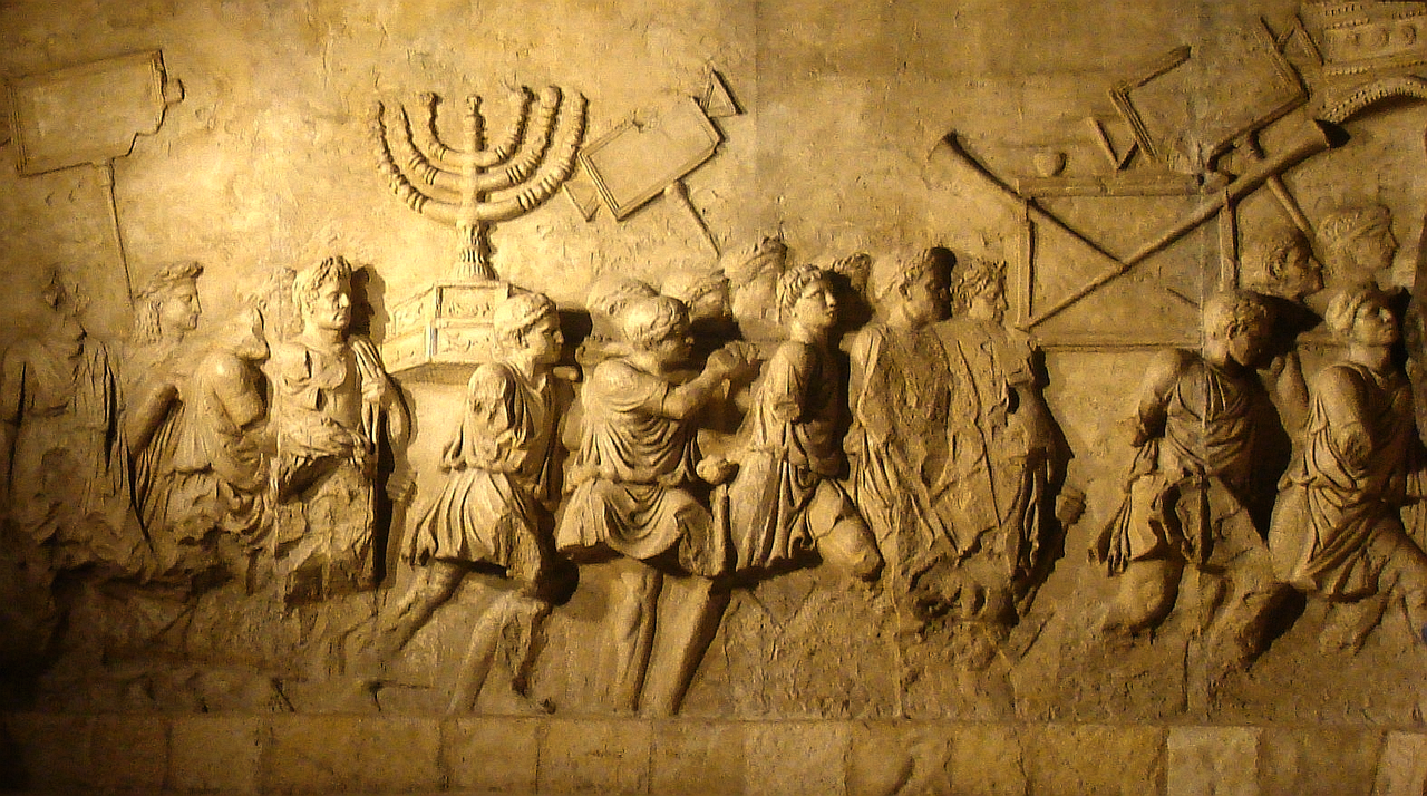 "In Rome the Arch of Titus still stands, depicting the triumphal parade of Roman soldiers leading away newly enslaved Jews, as they display the objects from the Temple they stole from them in the sack of Jerusalem and celebrate ""Judaea Capta"" -- that ""Judaea is enslaved/conquered"". Photo by Beth Hatefutsoth."