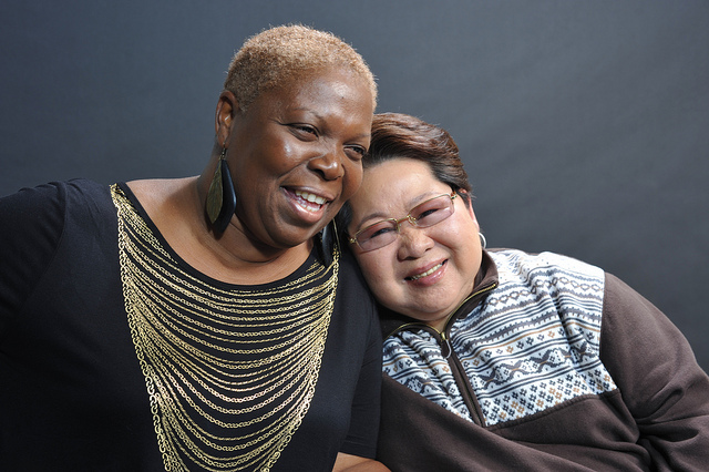 """Jennifer Bernard, a nun, and Tita Boots, a domestic caregiver share a moment while filming """"Help Is...,"""" a video series about domestic workers."""