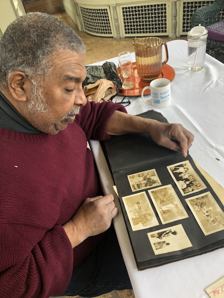 Doug Griffin looking through a photo album at Wistariahurst. Photo: Erika Slocumb