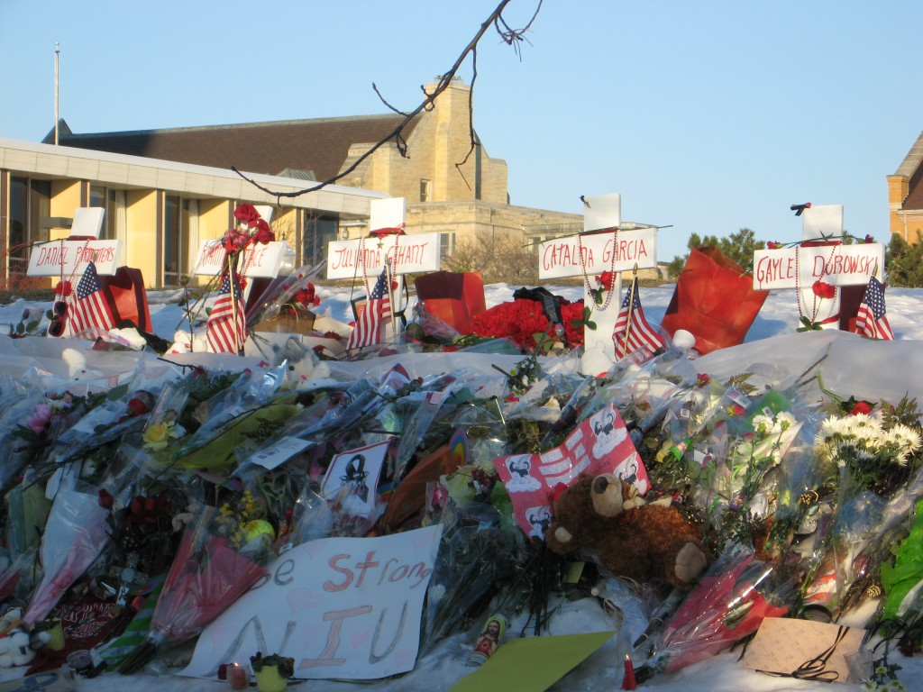 Crosses, flowers, signs, and other items left at a makeshift memorial site established near the MLK Commons at Northern Illinois University within a week of the February 14, 2008 shooting at NIU which killed six and injured 18 people. CC BY-SA 3.0